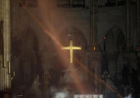 https://www.cbsnews.com/news/notre-dame-cathedral-on-fire-crucifix-altar-cross-paris/